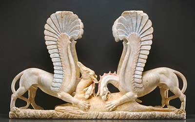 Marble table support in the form of griffins attacking a doe.